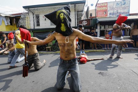 Filipino penitents during Lent engage in self-flagellation