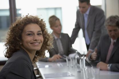 Portrait of happy businesswoman in meeting room