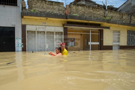 River overwhelmed floods the streets of the Peruvian city of Piura