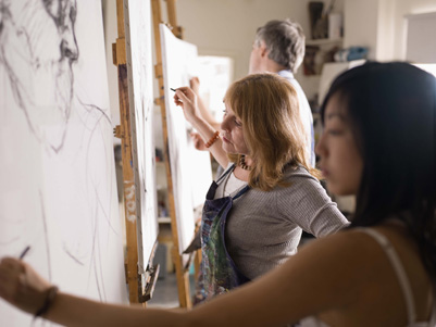 People drawing in art class